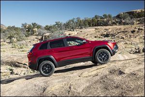 The 2014 Jeep Cherokee revives the Cherokee name, which was discontinued in 2002. Jeep says research revealed a fondness for the name, and the firm said feedback has not been 'disparaging.'