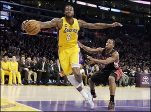Former Los Angeles Lakers forward Earl Clark (6) saves the ball that was heading out of bounds.
