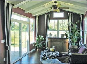 This bright sunroom offers wonderful views of the golf course.