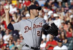 Detroit Tigers starting pitcher Rick Porcello delivers to a Cleveland Indians batter the first inning in Cleveland.
