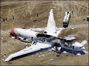 This aerial photo shows the wreckage of the Asiana Flight 214 airp