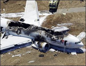 Passengers jumped down the emergency slides to safety as flames tore through Asiana Flight 214 after it crashed at the San Francisco International Airport.