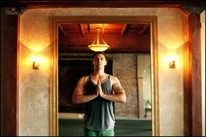 Sylvania resident Roget Aouad, an Iraq veteran who suffered post-traumatic stress, has found healing in practicing yoga.