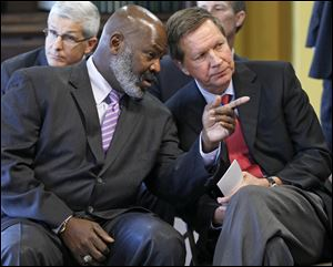 'Mike Bell is my buddy,' Ohio Gov. John Kasich, a Republican, has said of Toledo Mayor Mike Bell, an independent.