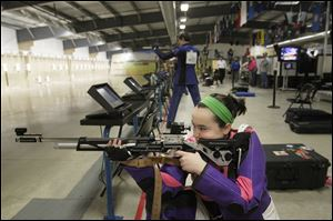 Sarah Sutton, 15, of Oak Harbor steadies herself before shooting at the Ottawa County 4H Club shooting team's practice session. The team, which has members from three counties, won the Ohio Junior Olympic 3 Position championship.