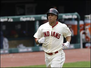 Cleveland Indians' Michael Brantley runs the bases after hitting a solo home run off Detroit Tigers starting pitcher Doug Fister in the sixth inning of a baseball game. Brantley added a game-winning two run blast in the eighth inning.