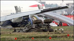 In this Jan. 17, 2008, file photo, the undercarriage shows from a British Airways Boeing 777 plane flying from China that landed short of the runway at London's Heathrow Airport. An official report said Thursday Sept 4, 2008, that ice in fuel lines probably caused the  British Airways jet to lose power and make a jarring emergency landing. Planes now are structurally sounder. In the cabin, stronger seats are less likely to move and crush passengers. Seat cushions and carpeting are fire retardant and doors are easier to open. Those improvements allow people to exit the plane more quickly.