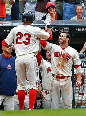 The Indians' Jason Kipnis, right, congratulates Michael Brantley after Brantley hit a two-run home run off the Tigers' Al Alburquerque in the eighth.