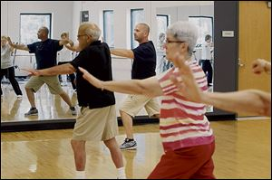 Instructor Joe Gray, center, leads a Tai Chi class at Francis Family YMCA in Temperance.