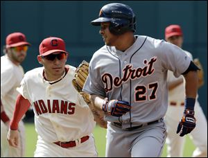 Cleveland Indians' Asdrubal Cabrera, left, tags out Detroit Tigers' Jhonny Peralta after Peralta attempted to advance to second base on a single in the third inning Saturday in Cleveland.