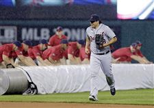 Detroit-left-fielder-Matt-Tuiasosopo-runs-for-the-du