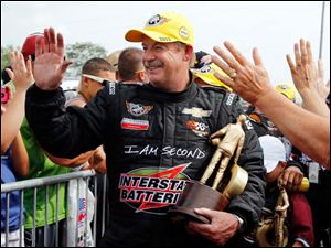 Mike Edwards celebrates winning the Pro Stock division in Norwalk.