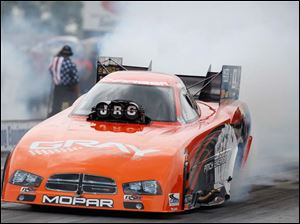 Johnny Gray wins the Funny Car division of the Summit Racing Equipment Nationals Sunday.