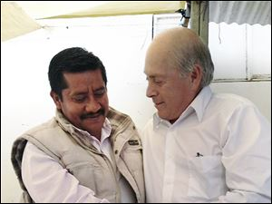 Baldemar Velasquez, right, president of the Toledo-based Farm Labor Organizing Committee, meets Mexico's Alberto Patishtan, a former Mexican college professor, in Tzotzil State Prison.