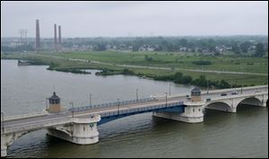 The Martin Luther King, Jr., Bridge spans the Mau-mee River just south of the site of the proposed Marina District in East Toledo.