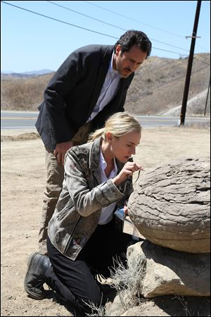 Demian Bichir as Marco Ruiz and Diane Kruger as Sonya Cross in a scene from 'The Bridge.'