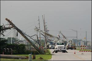 About 15 City of Bowling Green Department of Public Utilities power transmission poles are down and power is out along Dunbridge Road in Bowling Green. The damage is immediately south of a power substation.