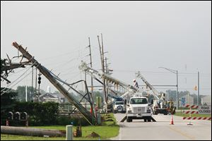 More than a dozen Bowling Green Department of Public Utilities electric poles were topped by a Sunday storm, leaving power out along Dunbridge Road in Bowling Green. Electric service was expected to be restored today.