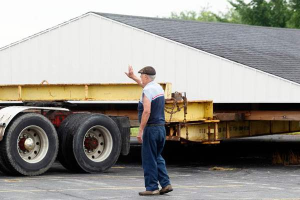Don-Brown-Sr-with-D-B-House-Movers-from-Monroe-MI-directs-the-driver