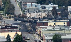 Damage in the downtown of Lac Megantic, Quebec is seen Sunday, July 7, 2013, the day after a train derailed causing explosions of railway cars carrying crude oil. (AP Photo/The Canadian Press, Paul Chiasson)