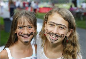 Gayle Rudolph, 9, left, and Jamie Byrd, 11, at the Fourth of July party at Belmont Country Club.