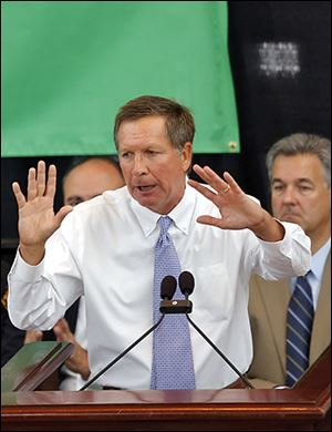 Gov. John Kasich attends a rally in the Ohio Statehouse to explain why the legislature should extend Medicaid coverage.