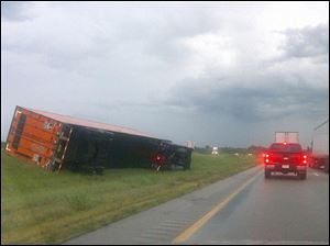 Several tractor-trailer rigs overturned on I-75 just south of Bowling Green, apparently because of high winds.