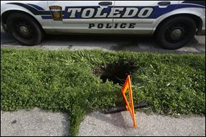 A two foot wide by five foot deep sink hole opened up on an unsuspecting East Toledo woman outside a home at 711 Nevada Street this afternoon.