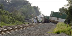 Derailed Norfolk Southern railcars block the east-west mainline in Williams County, near the community of Melbern, Ohio, three miles west of Bryan.