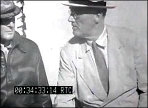 This image from the film clip provided by the National Archives shows President Franklin D. Roosevelt aboard the U.S.S. Baltimore in Pearl Harbor in July, 1944.