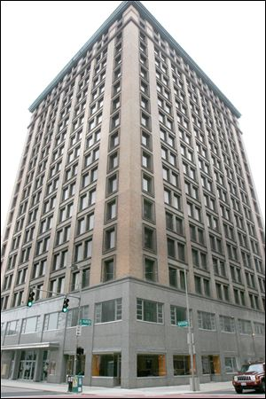 Officials say they are not sure what will happen next now that Koray Ergur has paid the back taxes he owed on the Nicholas Building. A sheriff's auction had been set to take place today.