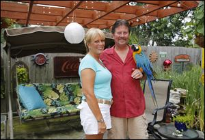 Tammy and Greg Wheeler in their Caribbean themed backyard.