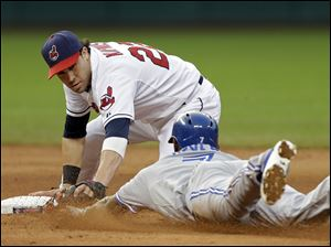 Cleveland Indians second baseman Jason Kipnis tags out Toronto Blue Jays' Jose Reyes, who was trying to stretch a hit into a double in the sixth.