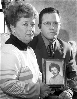 In this 2000 photo, Diane Dodd, left, and son Casey Sherman hold a photo in Rockland, Mass., of Dodd's sister Mary Sullivan, who was found strangled in January 1964 and is believed to have been the last victim of the Boston Strangler.