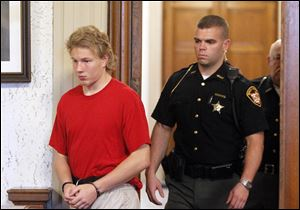 Michael Aaron Fay, 17, walks into the courtroom  for his arraignment as an adult.