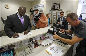 Toledo Mayor Mike Bell completes his paperwork today as he files to run for reelection at the Lucas County Board of Elections in Toledo.