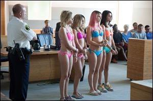 From left, Ashley Benson, Vanessa Hudgens, Rachel Korine, and Selena Gomez star in 'Spring Breakers.'