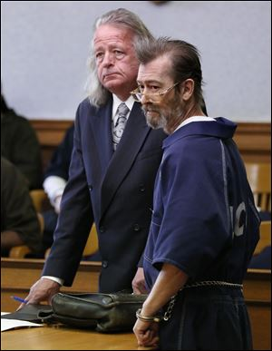 Aubrey Dale Marshall, 58, a registered sex offender, stood with attorney Adrian Cimerman at his May arraignment in Lucas County Common Pleas Court.