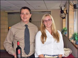 Jeffrey Ienna from Heidelberg Distributing Co. with Rachael Garvin, Toledo Yacht Club's summer intern, at the club's wine tasting party.