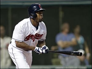 Cleveland Indians' Michael Bourn doubles to drive home two runs in the seventh inning against the Kansas City Royals.