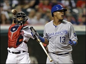Kansas City Royals' Salvador Perez (13) reacts after striking out against Cleveland Indians relief pitcher Cody Allen in the ninth inning.