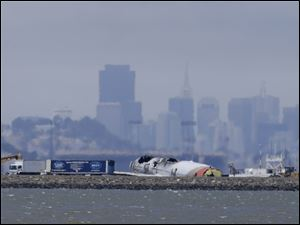 One of the victims in the Asiana Flight 214 crash was hit afterward by a fire truck, police said.