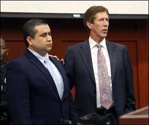 George Zimmerman, left,  stands in the courtroom with defense counsel Mark O'Mara during closing arguments in his trial at the Seminole County Criminal Justice Center, in Sanford, Fla., Friday.