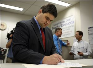 Toledo City Councilman Joe McNamara completes his paperwork today at the Lucas County Board of Elections as he files to run for mayor of Toledo.
