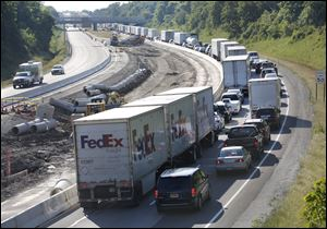 Backed up traffic on westbound lanes of the Ohio Turnpike Friday.