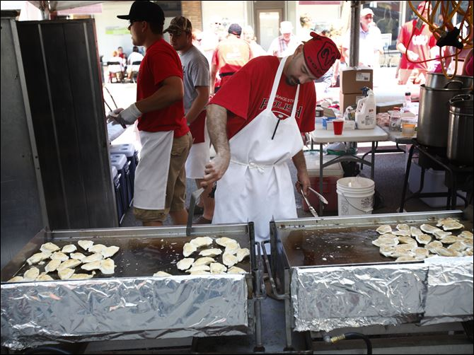 CTY lagrange14p Toledo resident Vincent Cope, Jr., makes pierogi during the 30th annual Lagrange Street Polish Festival.