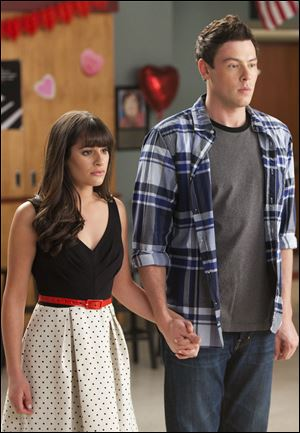 "Lea Michele, left, and Cory Monteith are shown in a scene from ""Glee.""  Monteith, who shot to fame in the hit TV series ""Glee"" but was beset by addiction struggles so fierce that he once said he was lucky to be alive, was found dead in a Vancouver hotel room, police said. He was 31."