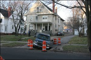 The city of Toledo is looking to see what caused a sinkhole in the 2000 block of Scottwood Avenue in the Old West End. The sinkhole, which is about 8 feet by 10 feet, was reported about 5 a.m. when a truck's front tire hit the hole and became stuck, said city spokesman Jen Sorgenfrei.