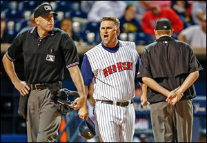 Toledo Mud Hens manager Phil Nevin argues with home plate umpire Jon Saphire during the ninth inning of a game against Lehigh Valley last month. Nevin was ejected from the game.