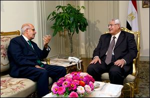 Mohamed Elbaradei, left, meeting with interim president Adly Mansour, right, at the presidential palace.